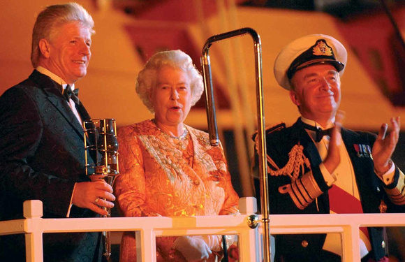Bruno Peek with The Queen and the First Sea Lord lighting the Trafalgar Day Bicentenary Beacon in 2005